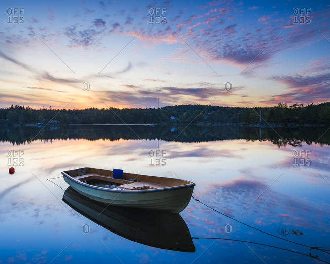 Rowing boat on lake at sunset
