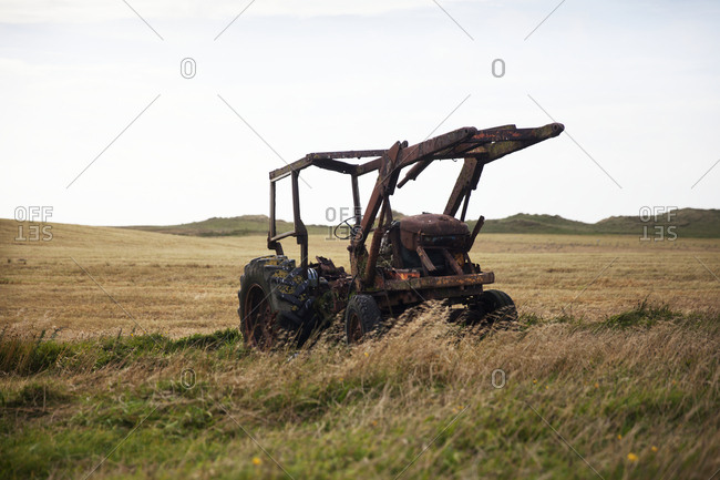 Old agricultural machine on meadow