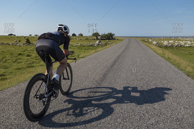 Man cycling on country road