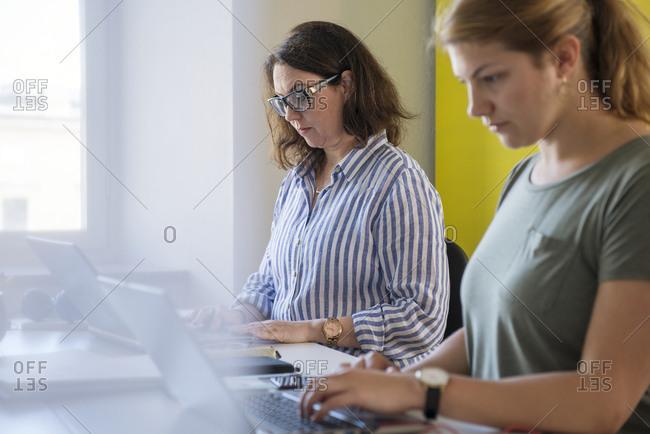 Women working on laptop in office