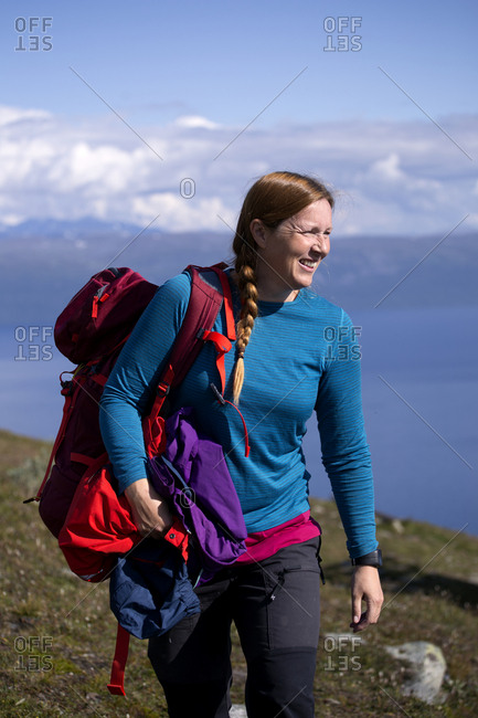 Woman trekking in mountains - Offset