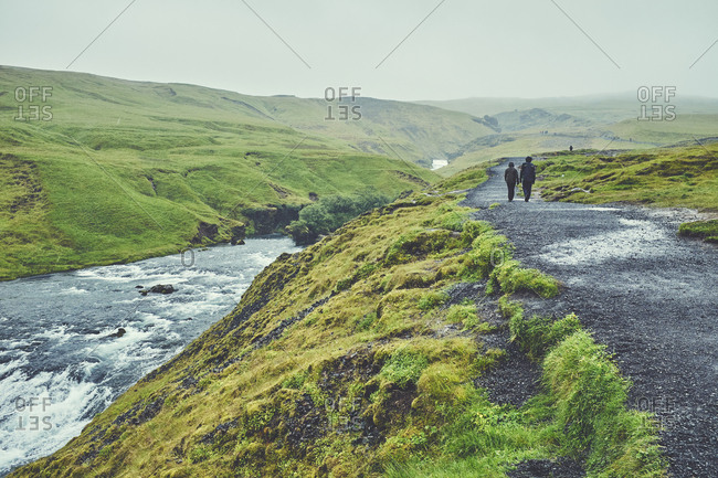 Tourists hiking near river
