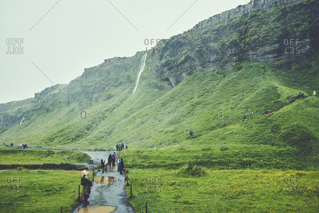 Tourists hiking in mountains
