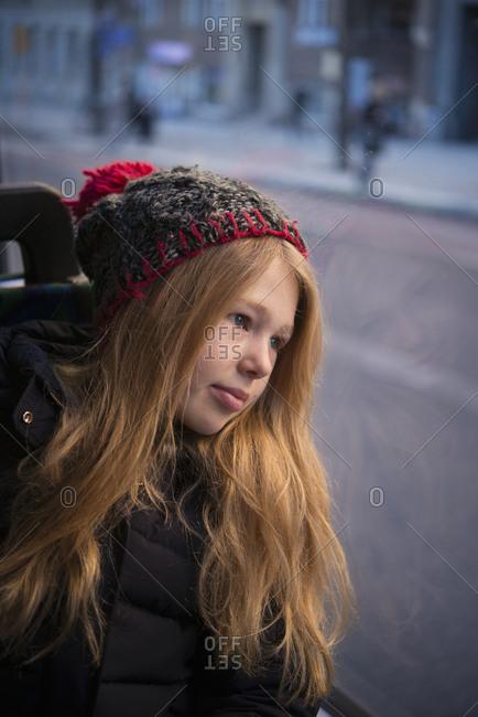 Girl looking through bus window