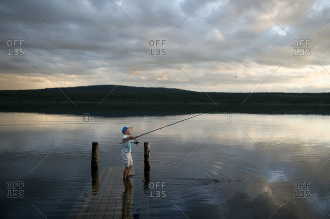 Boy fishing in lake