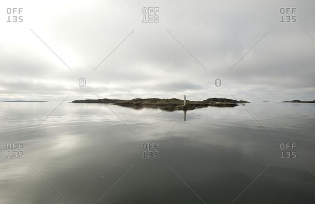 Small island reflecting in sea