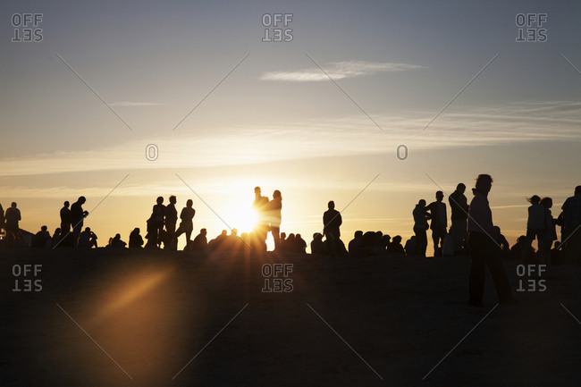 Silhouette of people in evening light