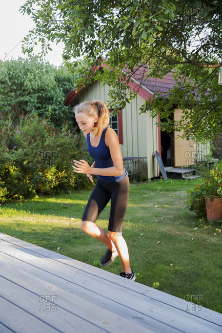 Girl exercising in garden
