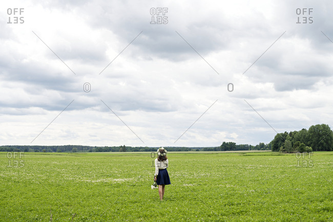 Woman wearing wreath in meadow