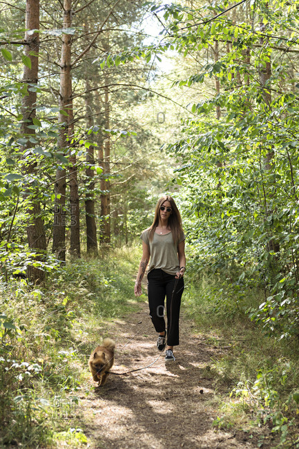 Woman with dog in forest