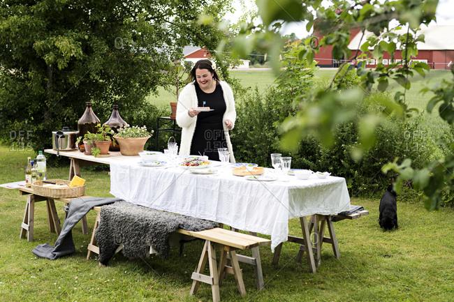 Woman preparing dinner party