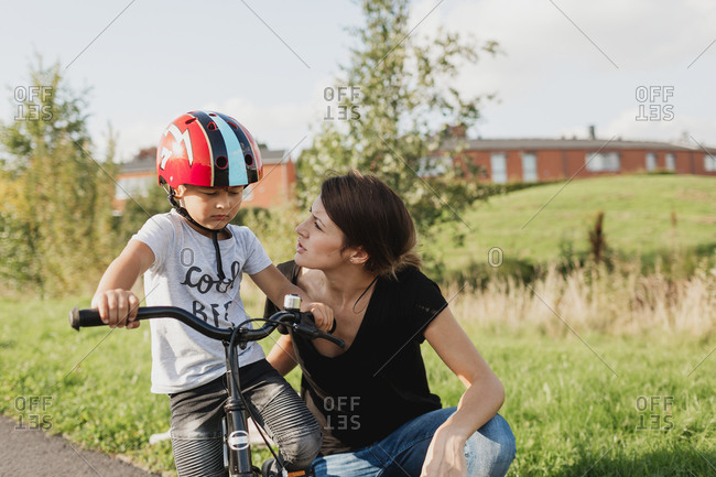 Mother with son on bicycle