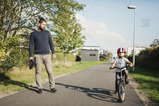 Father with son on bicycle