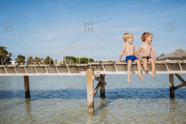 Boys sitting on jetty