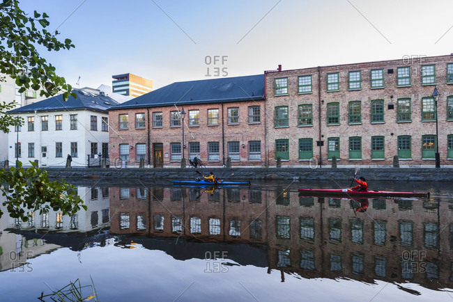 Gothenburg, Sweeden - October 6, 2017: Women kayaking through an urban area