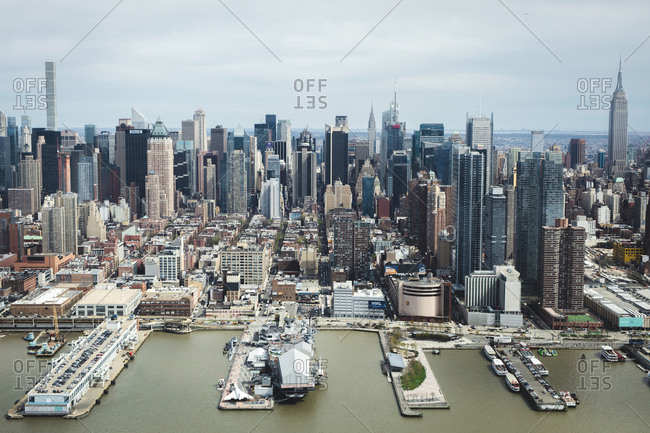 New York, NY - April 17, 2017: Aerial view of financial district with harbor