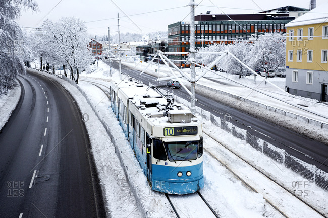 Gothenburg, Sweeden - January 19, 2016: Tram rounding a corner in winter
