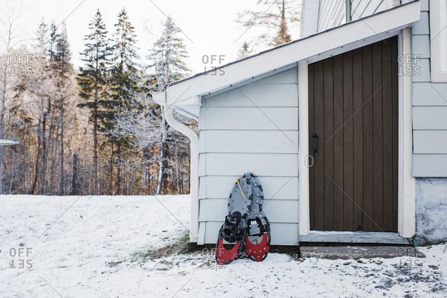 Snowshoes by house during winter