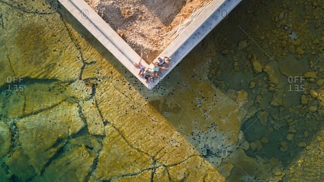 Aerial selfie of four friends on island Syros, Greece.