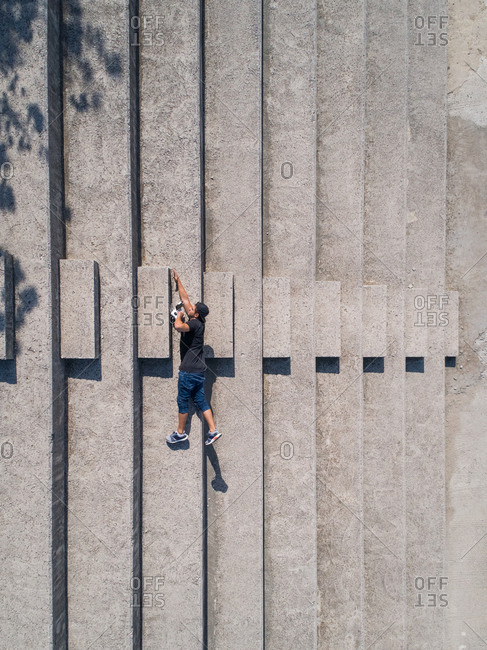 Optical illusion of a man falling created with a drone view.