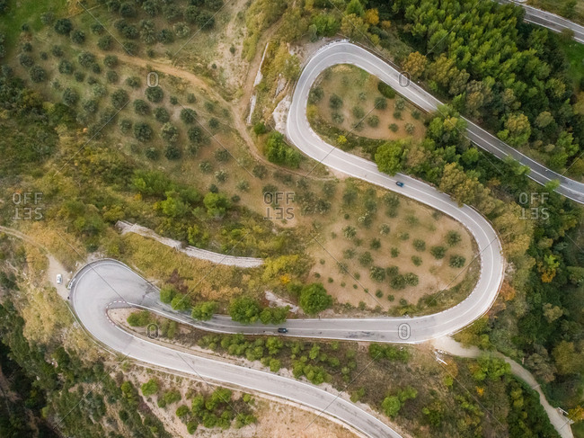 Aerial view of a zigzag road in countryside, Greece.