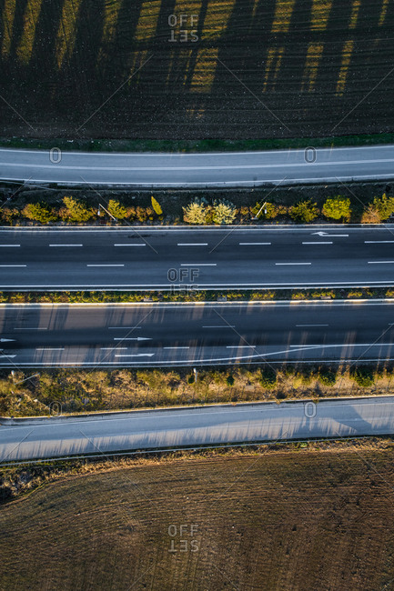 Aerial view of four roads in countryside.