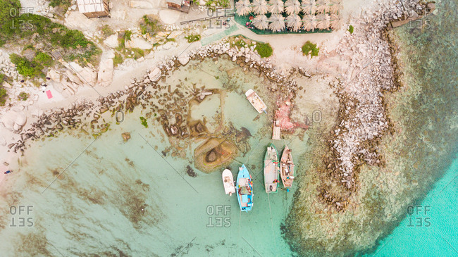Aerial photography of small boats in the Mediterranean sea in Villasimius, Sardinia, Italy.