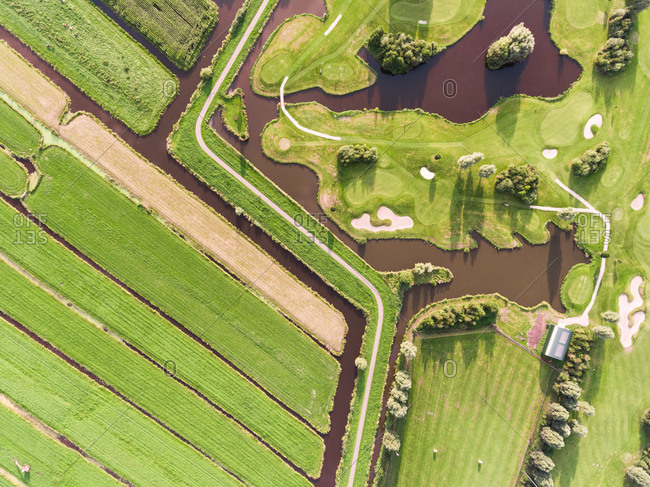 Aerial photography of green meadows and golf course in Krimpen aan de Lek.