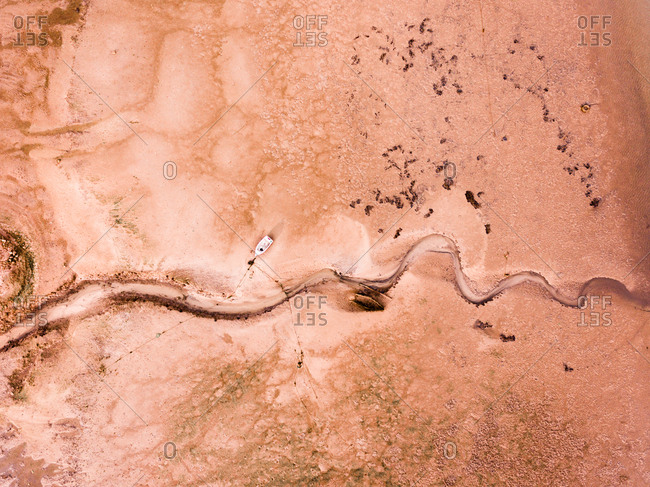 Aerial view of abandoned boat on the beach  of Olh�o, Faro, Portugal.