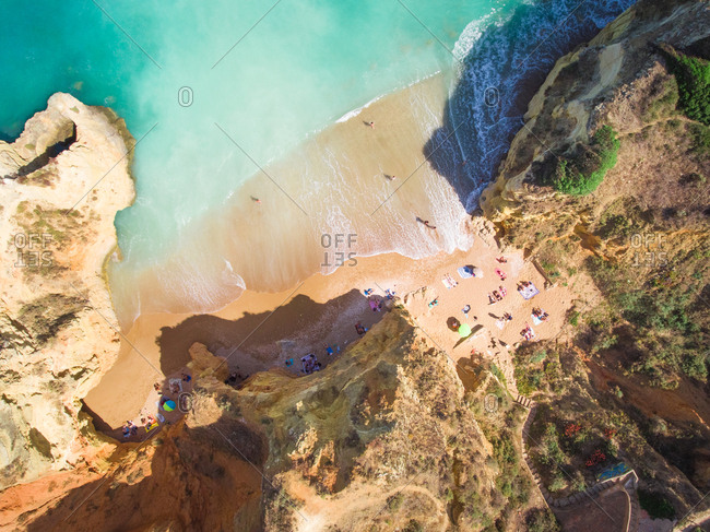 Aerial photography of Pinh�o Beach surrounded by cliffs in Lagos, Portugal.