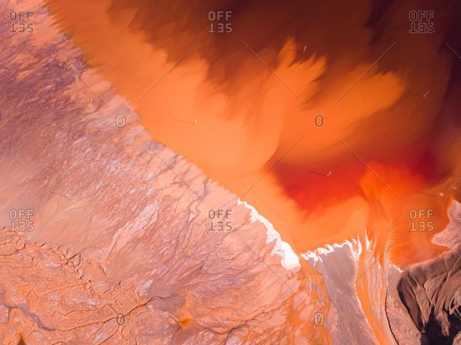 Aerial view of reddish tailing ponds in Perth, Australia.