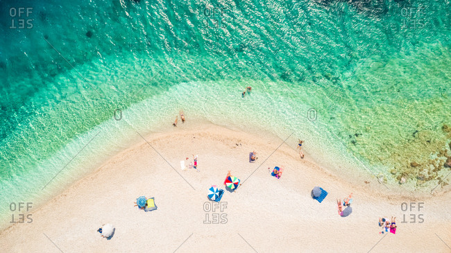 ITHACA ISLAND, GREECE - 7 August 2017 : Aerial photography of people on the beach of Agios Loannis, Ithaca Island, Greece.