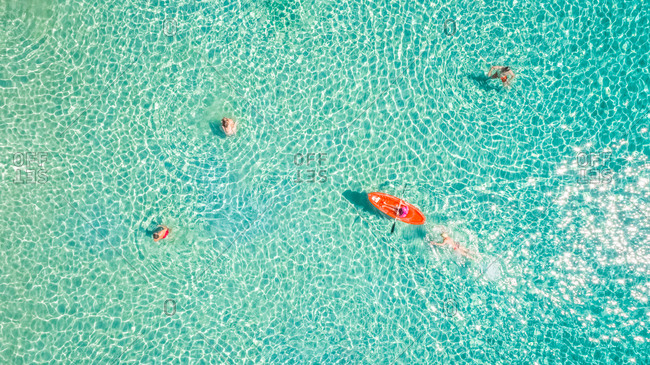 ISLAND OF SYROS, GREECE - 23 August 2017 : Aerial photography of people swimming in the sea of Poseidonia, Island of Syros, Greece.