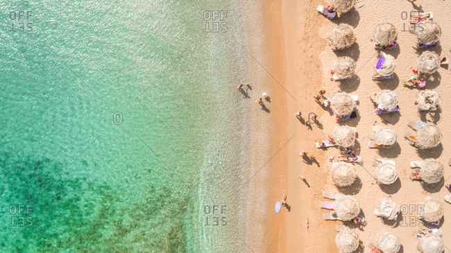 ANDROS ISLAND , GREECE - 27 August 2017 : Aerial photography of people on the beach of Kipri on Andros Island in Greece.