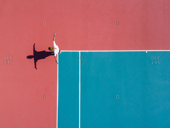 Aerial photography of a person on a tennis court.
