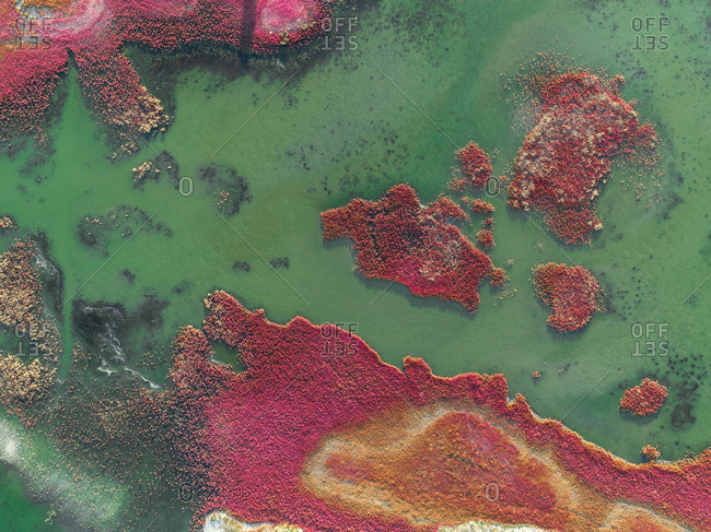 Aerial photography of the colorful Prokopou Lagoon in Greece.