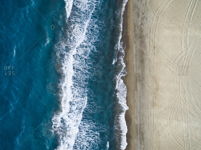 Aerial photography of the Kalogria beach with print in the sand, Greece.