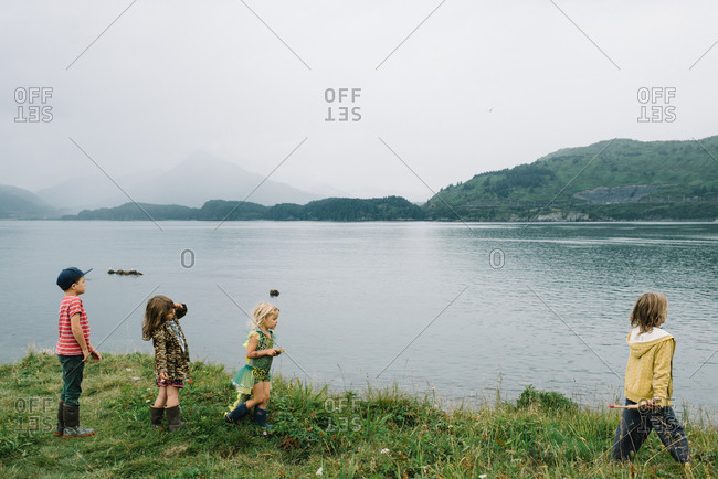 Group of kids exploring along lake shore