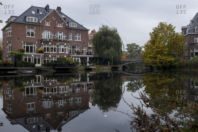 Amsterdam, Netherlands - October 30, 2016: Reflections on a canal next to Vondelpark