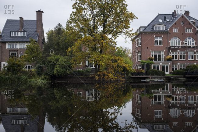 Reflections on a canal next to Vondelpark in Amsterdam, Netherlands