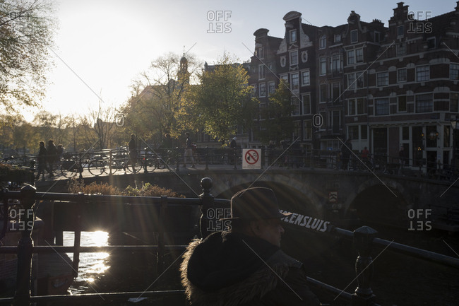 Amsterdam, Netherlands - October 31, 2016: Man enjoying Amsterdam's afternoon sun
