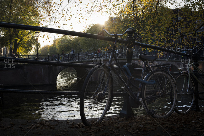Amsterdam, Netherlands - October 31, 2016: Bicycle parked next a canal in Amsterdam