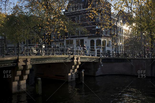 People crossing a bridge in Amsterdam, Netherlands