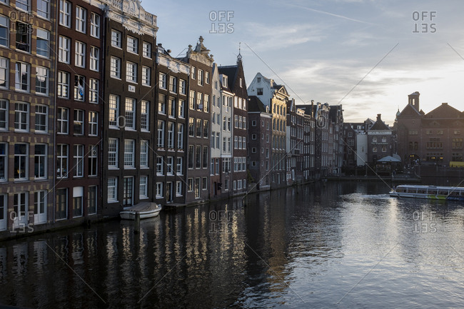 Amsterdam, Netherlands - October 31, 2016: Buildings on the water front in Amsterdam