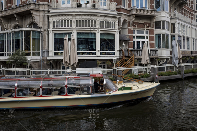 Amsterdam, Netherlands - November 1, 2016: Boat passing in an Amsterdam canal