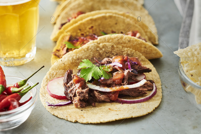 Shredded beef tacos with radish, onion and cabbage