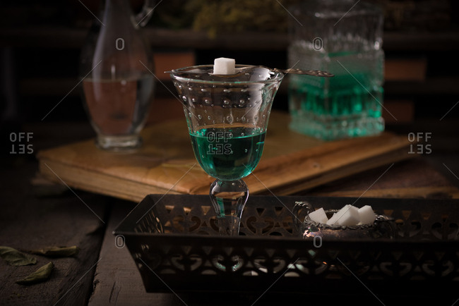 Absinthe served with a sugar cube