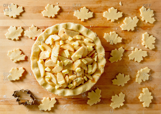 Cutting maple leaf shapes for apple pie