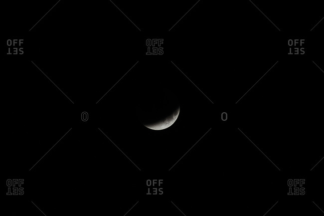 View of crescent moon during lunar eclipse