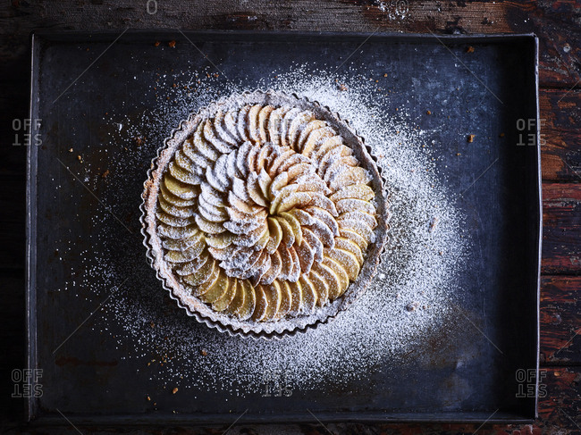 French apple tart dusted with confectioners' sugar